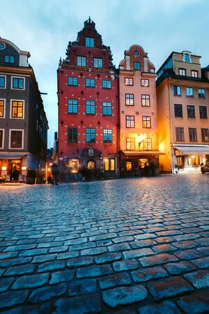 Classic view of colorful houses at famous Stortorget town square in Stockholm's historic Gamla Stan (Old Town) at night, central Stockholm, Sweden