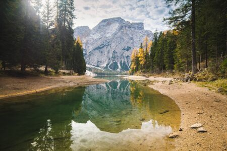 Scenic view of beautiful mountain scenery at famous Lago di Braies with Dolomites mountain peaks reflecting in calm water, South Tyrol, Italy