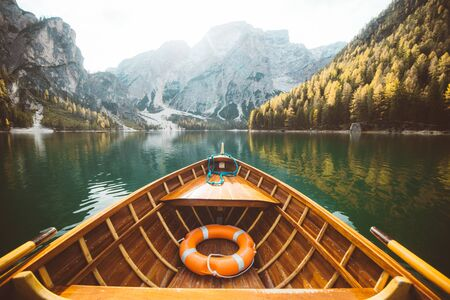 Beautiful view of traditional wooden rowing boat on scenic Lago di Braies in the Dolomites in scenic morning light at sunrise, South Tyrol, Italy 版權商用圖片