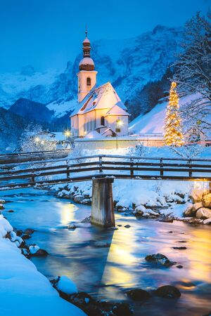 Beautiful twilight view of Sankt Sebastian pilgrimage church with decorated Christmas tree illuminated during blue hour at dusk in winter, Ramsau, Nationalpark Berchtesgadener Land, Bavaria, Germany 免版税图像 - 150559486