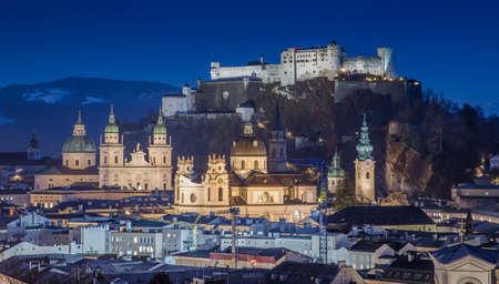Panoramic view of historic city of Salzburg with Festung Hohensalzburg and river Salzach during blue hour, Salzburger Land, Austria