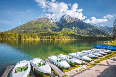 Beautiful view of traditional passenger boats on scenic Hintersee lake on a beautiful sunny day in summer, Bavaria, Germany