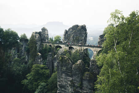 Beautiful panoramic view of famous Bastei Bridge with Elbe Sandstone mountains in Saxon Switzerland National Park on a moody day, Saxony, Germany 免版税图像 - 150931248