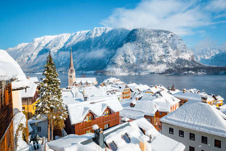 Panoramic view of the historic village of Hallstatt on a beautiful cold sunny day with blue sky and clouds in winter, Austria
