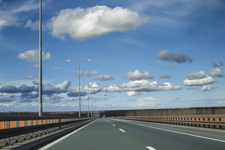 Vivid clody sky photo from a highway. Stock Photo
