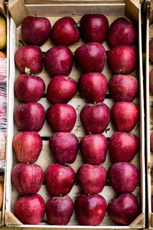 Purple apples in a wooden basket