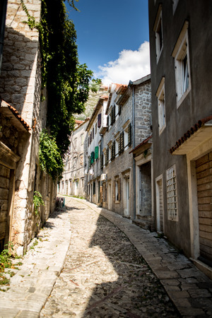 Narrow retro street with old buildings on the sides Stock Photo