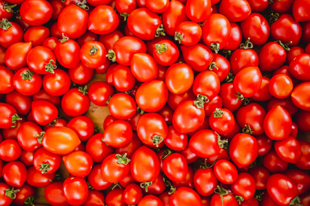 Delicious red tomatoes. Summer tray market agriculture farm full of organic vegetables
