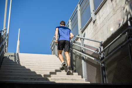 Male runner climbing up the stairs with ease