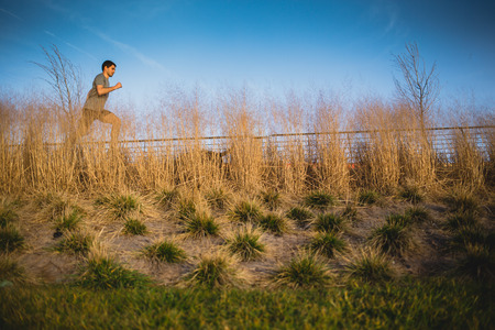 Male runner jogging on a riverside
