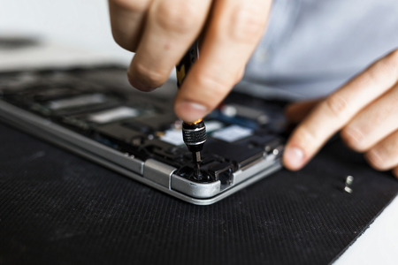 A view of the underside of an open laptop, prepared for fixing Imagens - 104975362