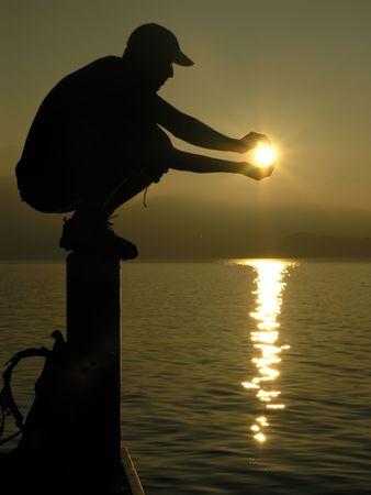 poetic: Boy holding the sun
