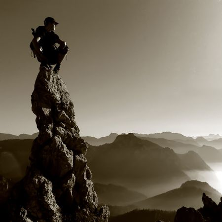 climbing: Mountain scenery - man on a rock top