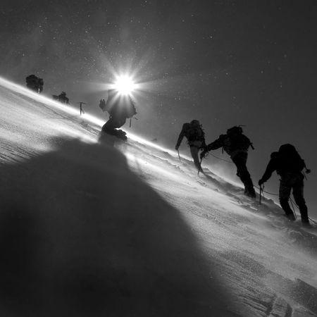 climbers: Climbers climbing the glacier Stock Photo