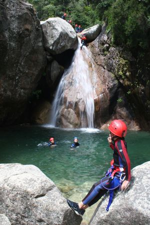 Adrenalin sport - Canyoning. Small child in foreground.
