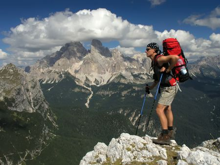 mounts: Tourist with backpack in the mountains Stock Photo