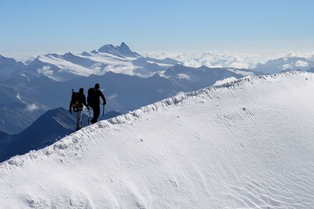 Climbers in high mountains photo