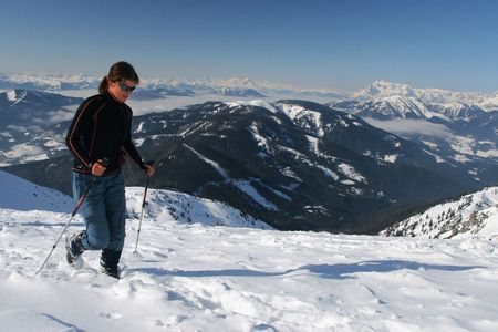 snowshoeing: Snowshoeing in the mountains Stock Photo