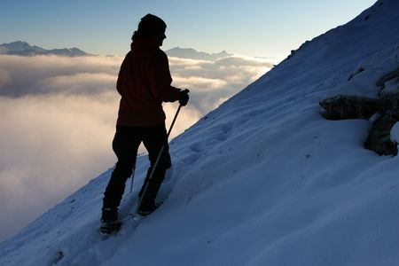 exacting: Winter mountain trekking - silhouette of a climber Stock Photo