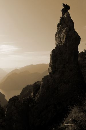 peace risk: Mountain scenery - man sitting on the top of a rock Stock Photo