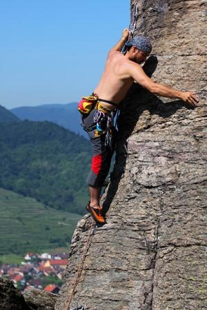 rockclimber: Male rock-climber  on a granite wall Stock Photo
