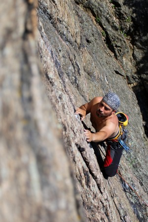 Male rock-climber  on a granite wall Stock Photo - 7132548