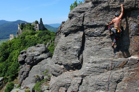 rockclimber: Male rock-climber  on a granite wall with magnificent view