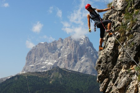 Young woman climbing in the Dolomits, Italy photo