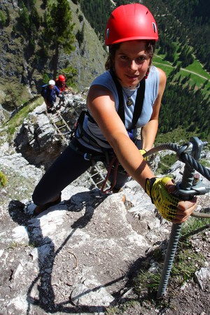 outdoor pursuit: Young woman climbing in the nature, outdoor pursuit. Stock Photo