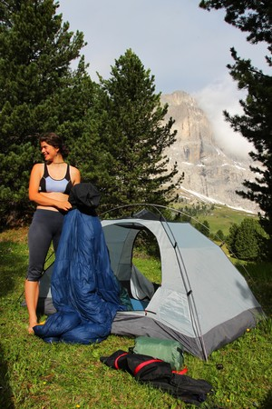 sleeping bag: Young woman in front of a tent  Stock Photo