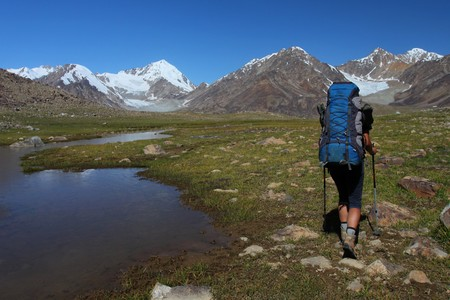 tajikistan: Trekker with backpack in Pamir, Tajikistan, Central Asia