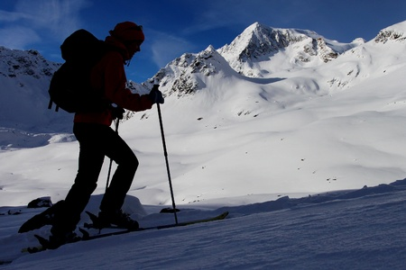 ski walking: Silhouette of mountaineer. Outdoor winter activity