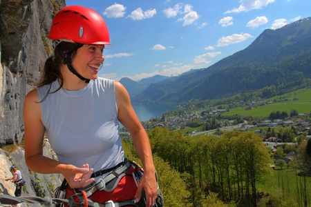 Woman rock climber with helmet, outdoor portrait Stock Photo - 9681411