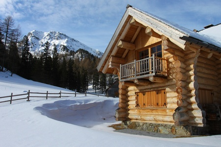 log cabin in snow: New log-cabin in winter mountains, Upper Austria
