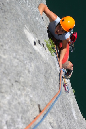 Summer climbing. Young woman climbing a limestone rock Stock Photo - 9769068