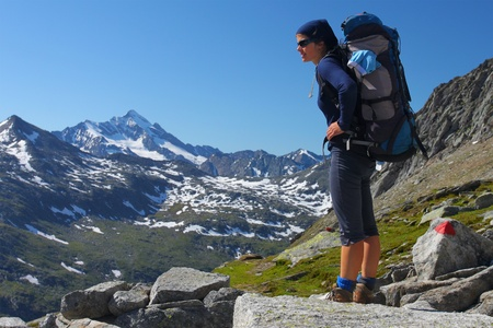 backpacking: Young woman trekking in the Austrian Alps
