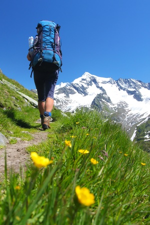 austrian: Hiker on a mountain path in the Austrian Alps