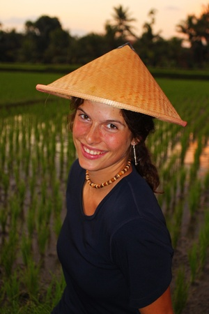 Young woman with traditional conical asian hat photo