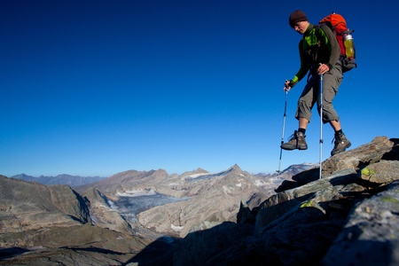 altitude: Mountain hiker with backpack high in the mountains