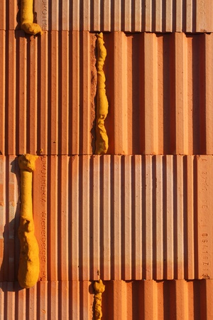 walling: New wall of a house build of clay blocks