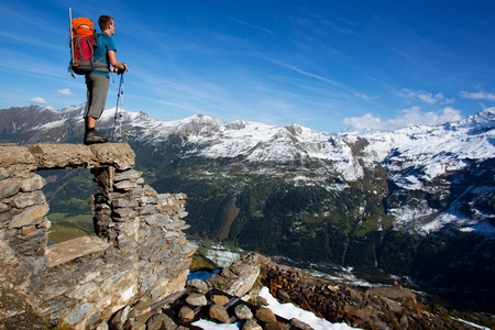 tauern: Young man with backpack enjoying mountain view