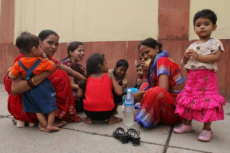 poverty india: DELHI, INDIA - JULY 31: Indian women and children sitting on a street July 31, 2008 in Delhi, India