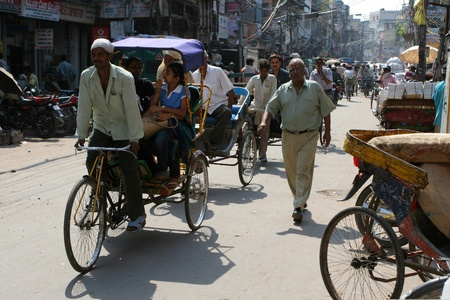 DELHI, INDIA - SEPTEMBER 6: Cycle rickshaws and crowds of people in the streets of Delhi September 6, 2008 in Delhi, India Stock Photo - 10912080