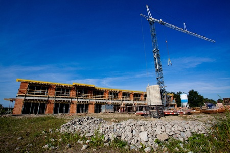 Construction of block of flats with a crane photo