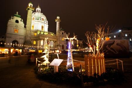 Christmas market in front of Karlskirche, Vienna, Austria