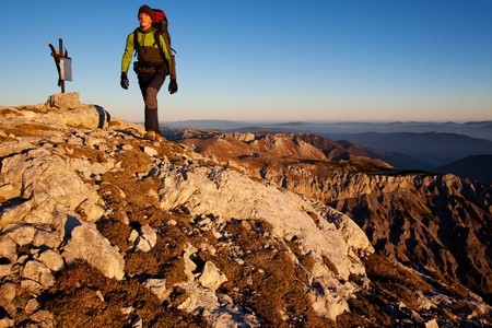 Young man with backpack on a mountain hike Stock Photo - 12502284