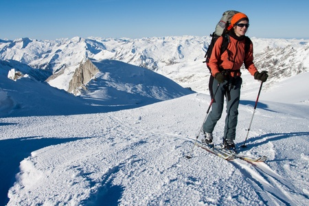 Young woman doing ski touring. Outdoor winter activity photo