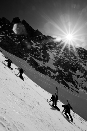 Group of alpine climbers ascending the snow slope photo
