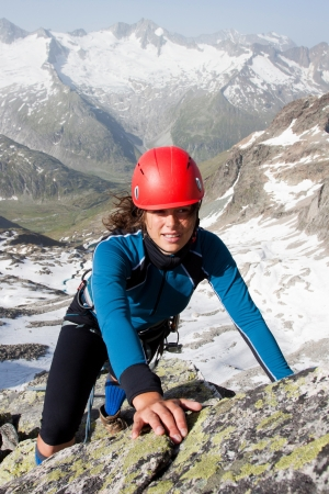 outdoor pursuit: Woman climber in summer Austrian Alps Stock Photo