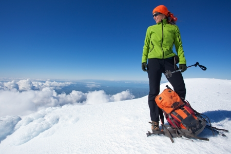 Young woman at the top of volcano in winter condition photo